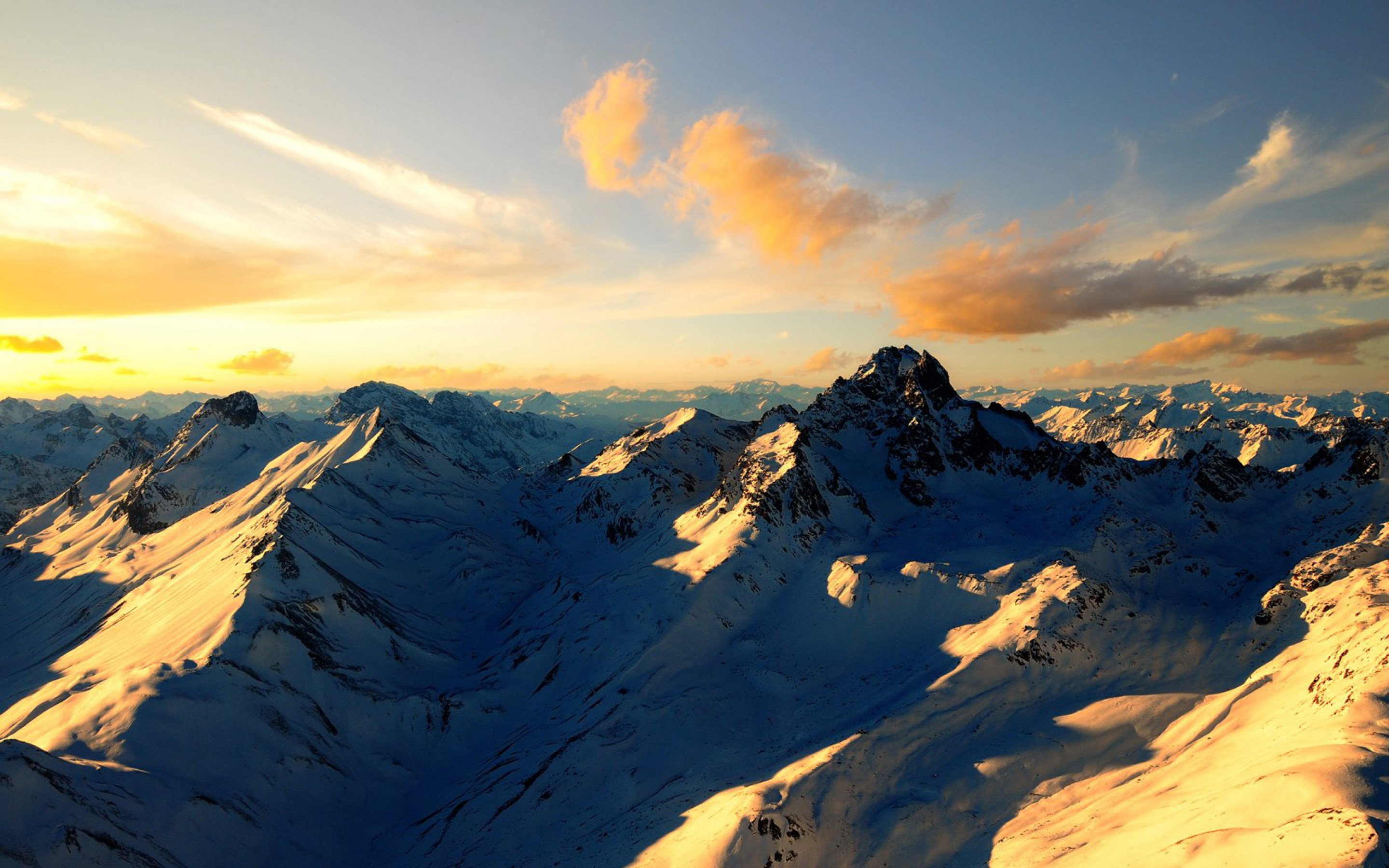 Sunset Over Snow Capped Mountains Full HD Wallpaper And Background